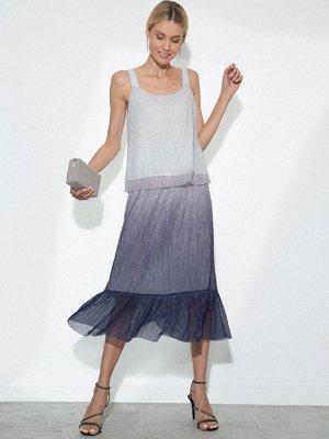 Юбка Остав ткани: Полиэстер 100% Описание модели Чарующая юбка с градиентным переходом от серебряного оттенка к глубокому синему. Сияющие нити, напоминающие звёздное небо, пронизывают всю ткань. Модел