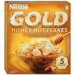 Хлопья Nestle Gold Flakes хрустящие кукурузные с медом и арахисом 300 г