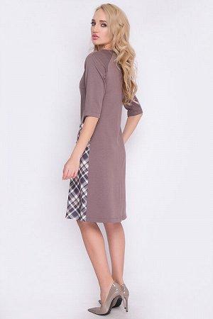 Платье Платье А-силуэта из трикотажа с вставкой по переду из мелкой клетки контрастного цвета. Рукав реглан.По переду декоративные пуговицы. 50% вискоза,45% п/э,5% лайкра