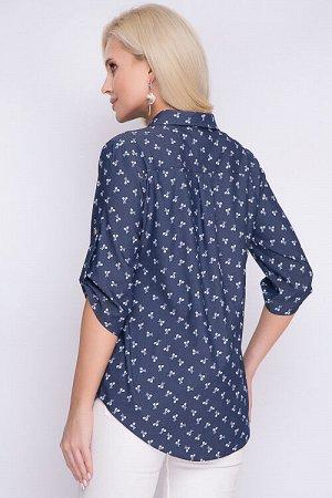 Рубашка Рубашка из облегченной джинсовой ткани свободного силуэта.Центральная застежка на петли и пуговицы до низа.Воротник рубашечного типа на стойке.По спинке кокетка.Рукав втачной на пате 70 % хло