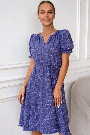 Платье Размер: 42 / 48 Это платье - настоящее воплощение васильковой мечты! Пышный короткий рукав, летящая юбка, легко присборенная на резинку талия, очаровательный принт-горошек и кокетливый вырез на