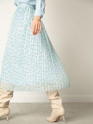Юбка Состав ткани: Полиэстер 100% Длина: 87 См. Описание модели Плиссированная юбка А-силуэта и длины миди. Модель нежно-голубого оттенка с аккуратным цветочным принтом. Застёгивается на скрытую боков