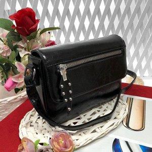 Женская сумочка-коробочка Ganza с ремнем через плечо из глянцевой эко-кожи чёрного цвета.