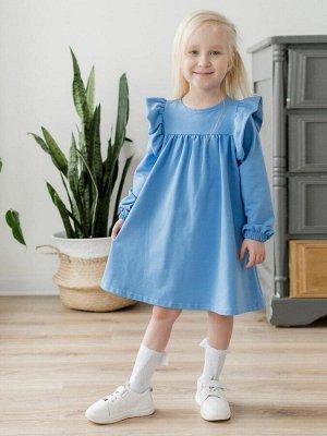 """Платье Платье свободного силуэта, из футера голубого цвета для девочки . Отрезная кокетка, со сборкой по линии груди. Сзади по спинке - застежка-молния. Длинные рукава украшены двойными воланами-""""крыл"""