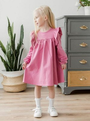 """Платье Платье свободного силуэта, из футера розового цвета для девочки . Отрезная кокетка, со сборкой по линии груди. Сзади по спинке - застежка-молния. Длинные рукава украшены двойными воланами-""""крыл"""
