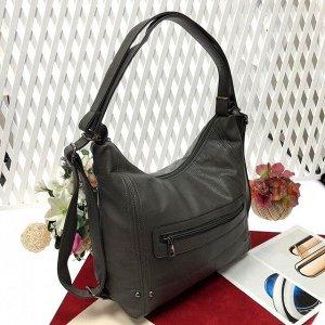 Функциональная сумка-рюкзак Gee_Gu из качественной матовой эко-кожи чёрного цвета.