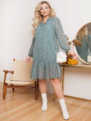 """Платье Платье А-образного силуэта, выполнено из шифона на подкладе. - принт""""цветы"""" - горловина с фигурным вырезом оформлена рюшей и завязками - длинные втачные рукава собраны на резинку - низ раскле"""