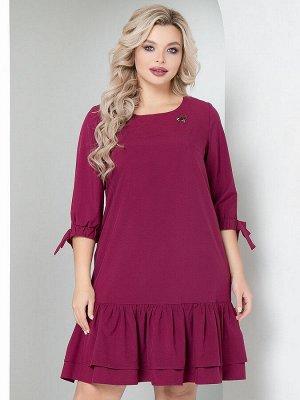 Платье Платье А-образного силуэта, выполнено из костюмной ткани . - однотонная расцветка - вырез горловины круглый на внутренней обтачке - втачные рукава длиной 3/4, на манжетах с резинкой и завязкам