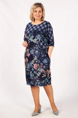 Платье Нарядное весеннее платье, с ярким цветочным принтом. Выполнено из мягкого, приятного к телу трикотажа. Модель свободного кроя, рукав втачной, длиной 3/4, со спущенной линией плеча. Вырез горлов