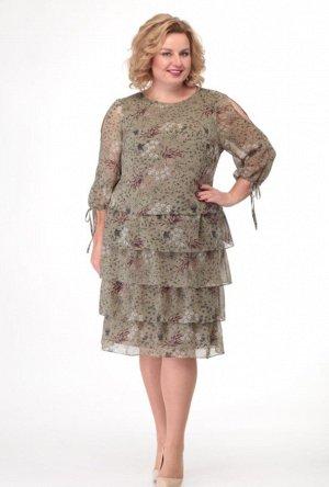 Платье Очаровательное шифоновое платье на подкладке, отрезное по линии талии. Перед с нагрудными вытачками. Спинка цельная. По нижней части платья 4 ряда притачных воланов. Рукав втачной, состоящий из