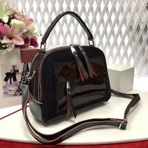Лаконичная сумочка Vittoria из натуральной кожи в сочетании с натуральной замшей цвета горького шоколада.