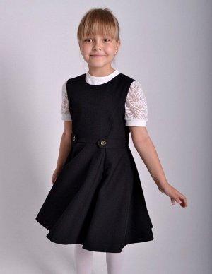 Черный Цвет: черный. Ткань – костюмная поливискоза, 50% вискоза, 50% ПЭ  Сарафан отрезной по линии талии, с декоративными патами. Расклешенная юбка с глубокими складками спереди и сзади смотрится очен