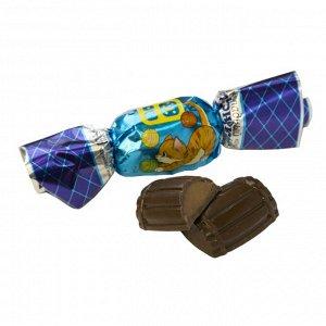 Конфеты Конфеты «Бочонок с шоколадной начинкой» - это аппетитное лакомство из шоколадной глазури, выполненное в виде полубочонков, заполненных сливочной начинкой. Конфета обладает приятным молочным вк