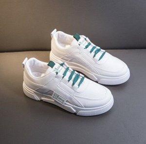Женские кроссовки, цвет белый, зеленые шнурки