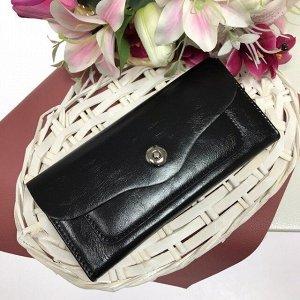 Женский кошелек Fartuna из глянцевой эко-кожи чёрного цвета.