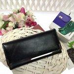 Женский кошелек Hugordo из мягкой эко-кожи чёрного цвета.