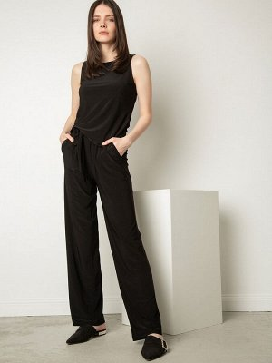 """Брюки В коллекции """"Блузки"""" вы можете собрать себе костюм с этими брюками! Состав ткани: Вискоза 70%, Нейлон 25%, Эластан 5% Длина: 105 См. Описание модели Универсальный брюки в чёрном цвете с эластичн"""