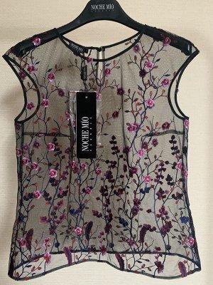 Блуза Блуза NOCHE MIO 6.786-1  Состав: ПЭ-100%; Сезон: Весна-Лето Рост: 164  Блузка из чёрного фатина с яркой вышивкой.Чёрный топ не идёт в комплекте.
