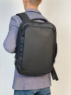 Рюкзак мужской.(выполнен из плотной водонепроницаемой ткани).