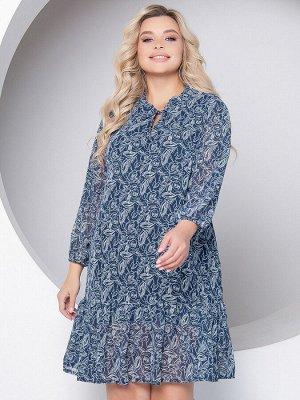 Платье Платье А-образного силуэта, выполнено из шифона на подкладе. - растительный принт - горловина с фигурным вырезом оформлена рюшей и завязками - длинные втачные рукава собраны на резинку - низ р