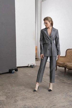 Брюки Брюки женские из костюмно-плательной ткани, прямые, на притачном поясе. Застежка брюк в верхней части среднего шва передних частей на тесьму-молнию, одну петлю и пуговицу. Передние части брюк с