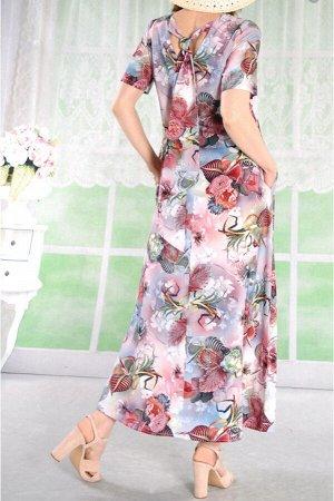 Платье Платье макси из штапеля с завязками на спине.Трапецевидного силуэта.В шов на спинке вставлена потайная молния. размер 42,44 об.груди 94 об.бедер 112 длина 126         размер 46,48 об.