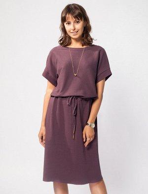 Свободное платье из трикотажа в рубчик, с асимметричным кроем верха и низа, с поясом-шнуром на кулиске.