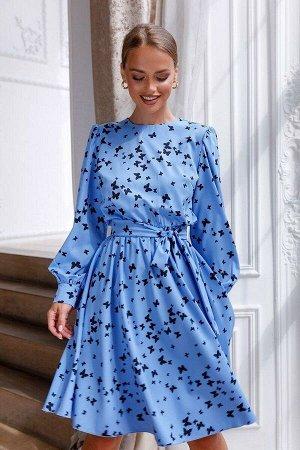 Платье Лёгкое, словно бабочка, платье выполнено из ткани Ниагара в нежно-васильковом оттенке. Принт с сотнями бабочек подчёркивает воздушность модели и хрупкость образа. Длинный, широкий рукав-баллон