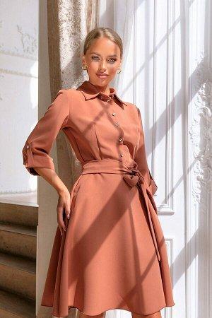 Платье Платье модели 4885 можно сделать основой любого модного гардероба. Интересный оттенок материала, напоминающий замш. Рукав 3/4, укорочен с помощью петли, пояс подчёркивает талию, спереди застёжк