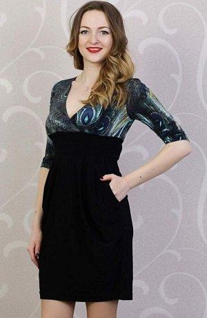 Платье Красивое платье, полу прилегающего силуэта, выполнен из трикотажного полотна, верх принт перья павлина, низ чёрный. Вырез V- образный на запах. Рукав 3/4. С карманами. Без подклада. Состав верх