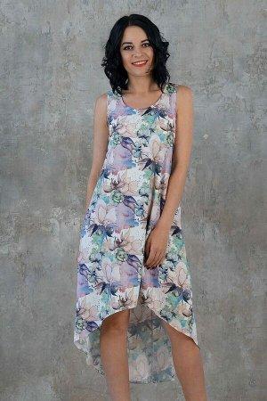 Платье Красивое платье свободного силуэта. Выполнено из плательной ткани. Расцветка акварельные цветы на голубом. Круглый вырез горловины. Без рукавов. Низ платья ассиметричный. Без подклада. Без заст