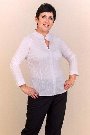 Блуза Блуза свободного силуэта, выполнена из сорочечной ткани. Расцветка белая. Воротник стойка. Без застёжки. Длинные втачные рукава помогут сохранить тепло и комфорт. Аккуратный покрой блузы позволи