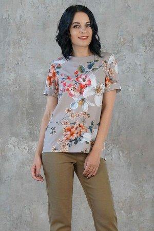Блуза Блуза прямого силуэта. Выполнена из эластичной блузочной ткани. Расцветка цветы на серо-зелёном. Круглый вырез горловины. Короткие рукава 20 см. Застёжка молния по спинке. Без подклада. Блуза пр