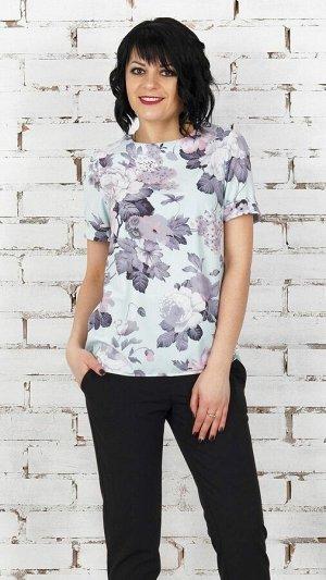 Блуза Блуза прямого силуэта из эластичной блузочной ткани. Вырез круглый. Рукав короткий 19 см с отворотами. Низ асимметричный. Без подклада. Застёжка пуговка по спинке. ДИ в 42-44 р полка 58 см спи