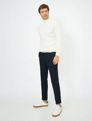 брюки Материал: %40 Akrilik, %30 Polyester, %20 Хлопок, %5 Viskoz, %5 Y?n Параметры модели: рост: 189 cm,грудь: 99,талия: 75,бедра: 99 Modelin Bedeni: 42