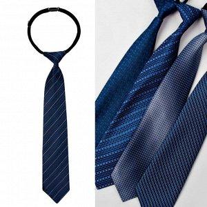 Галстук ЦВЕТ: синий (узор микс),  Замеры модели* * рост указан приблизительно, ориентируйтесь на замеры *Размер 31 см (длина галстука 31 см) *Модель без права выбора рисунка. Галстук-регат с оригина