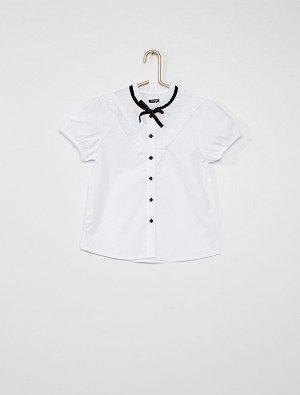Рубашка Материал верха 55% ХЛОПОК, 45% ПОЛИЭСТЕР; Рубашка с бархатным бантиком!<br>- Рубашка <br>- Высокий воротник с воланами <br>- Короткие рукава<br>- Оригинальный бантик впереди <br>- Застежка на