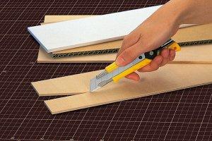 Нож OLFA с выдвижным лезвием эргономичный
