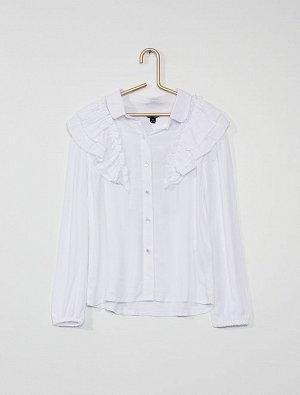 Рубашка Материал верха 100% ВИСКОЗА; Очаровательная белая рубашка с оборками! <br>- Рубашка <br>- Рубашечный воротник <br>- Пуговицы-бусины <br>- Длинные рукава с манжетами на резинке <br>- Широкие об
