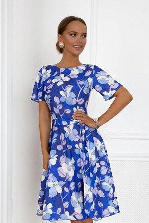 Платье Нежное платье, сшитое из ткани в цветочек, стало символом солнечной летней поры. Яркий и насыщенный наряд выделит Вашу индивидуальность.Основной цвет платья-синий - игривый и волнующий , на кот
