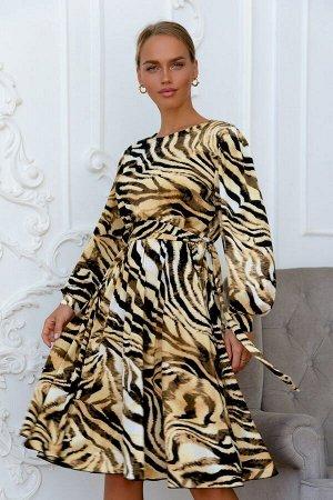 Платье Платье из лёгкого струящегося трикотажа масло в анималистичной расцветке обязательно понравится провокационным, смелым и дерзким модницам! Актуальные в этом сезоне широкие рукава ограничены ман