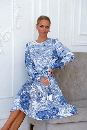 Платье Платье из трикотажа масло с восточным узором никого не оставит ровнодушным. Особую магию модели придаёт оттенок синего, который плавно переходит к юбке и рукавам, становясь более глубоким и тем