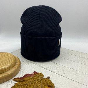 """Шапка Бесспорный лидер продаж шапка-бини """"Долорес"""", в черном цвете, который вписывается в любой образ, гармонично его завершая. Декорирована оригинальным металлическим элементом. Размер 56-58см. Cоста"""