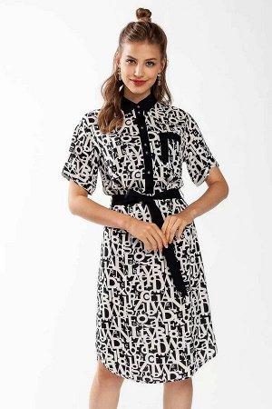 Платье Прямое платье-рубашка из принтованной вискозы. Стояче-отложной воротник, планка , деталь кармана и пояс выполнены из однотонной черной ткани и являются заметными акцентами платья. Застежка на п