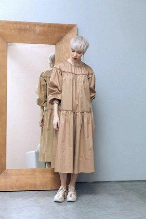 Платье Стильное платье в стиле бохо. Платье расширенного силуэта. Круглый вырез горловины с застежкой по спинке изделия на навесную петлю и пуговицу. Втачной рукав реглан, манжета на резинке. Длина ни