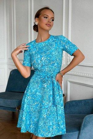 Платье Яркая расцветка ткани как само лето! Очень популярныая модель в голубом исполнении. Не глубокий вырез и рукавчик подчеркнут платье в выгодном стиле. Ремешок идет в комплекте