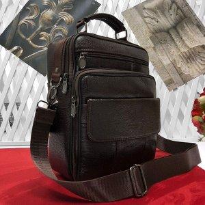 Мужская сумка Detrix формата А5 из мягкой натуральной кожи с ремнем через плечо кофейного цвета.