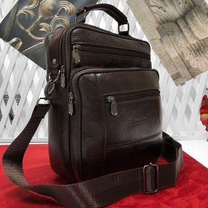 Мужская сумка Kurshe формата А5 из мягкой натуральной кожи с ремнем через плечо кофейного цвета.