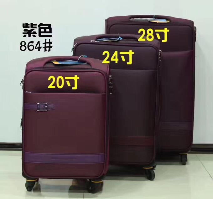 чемодан 20 дюймов (размер 55/35/22см). Солидный качественный чемодан. Множество карманов, 4 колеса, кодовый замок. Материал верха - нейлон. Это  международной размер стандартного чемодана ручной клади