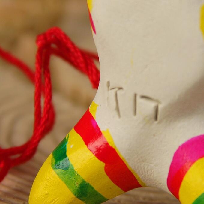 Филимоновская игрушка - свисток «Собака»